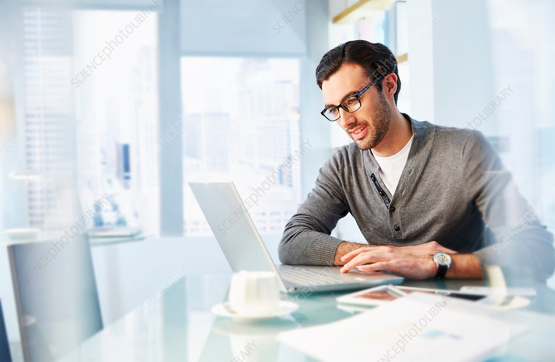 Man working using laptop in office
