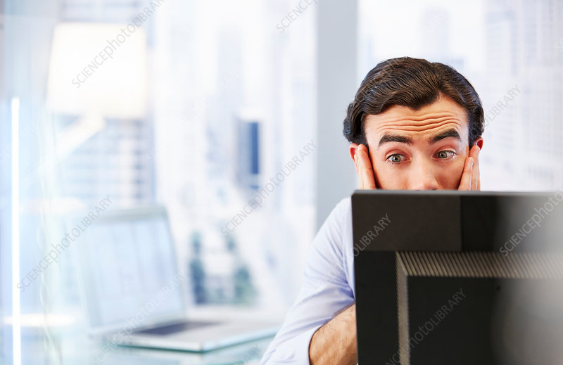 Man using computer, stressed and worried