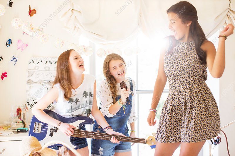 Girls playing music and singing in room