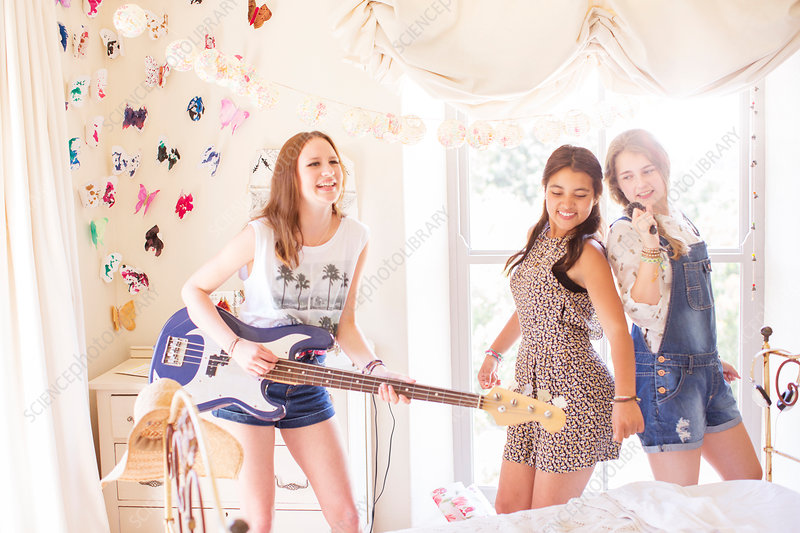 Girls playing music and singing