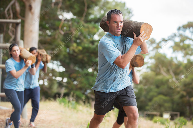 Determined man running with log