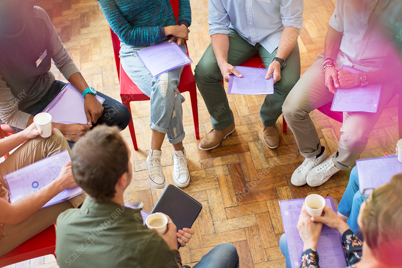 Group therapy session forming circle
