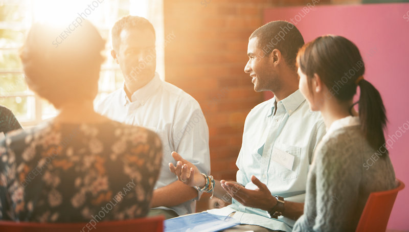 Man talking in group therapy session