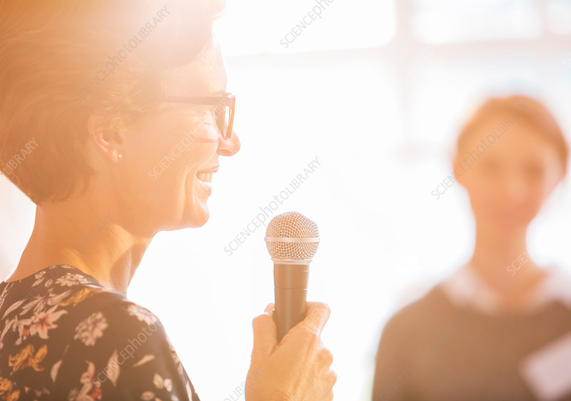 Close up woman speaking with microphone