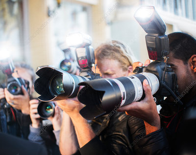 Close up of paparazzi photographers