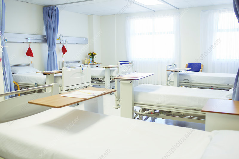 Beds ready in empty hospital room