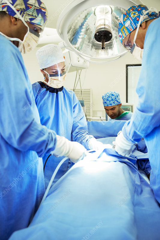 Surgeons during surgery in operating room