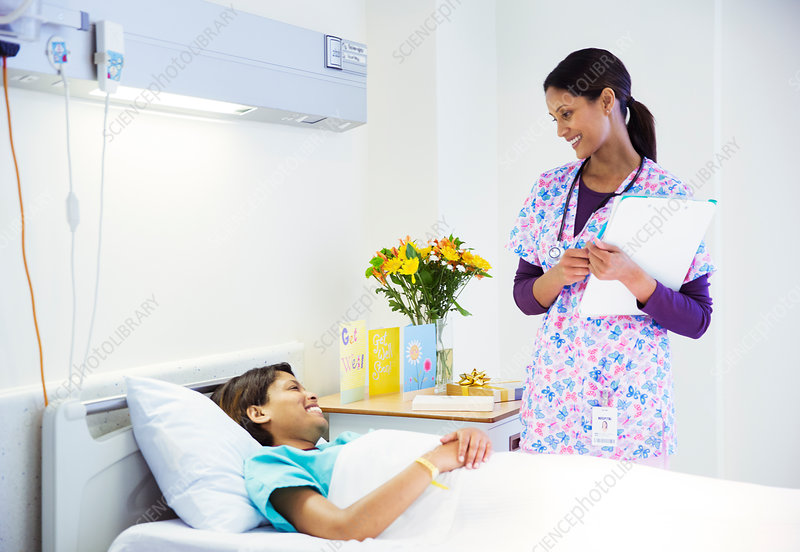 Nurse talking to patient in hospital room