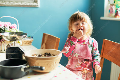 Girl tasting baking ingredients