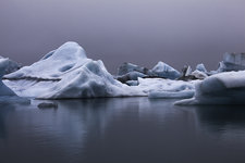 Blue icebergs in calm water