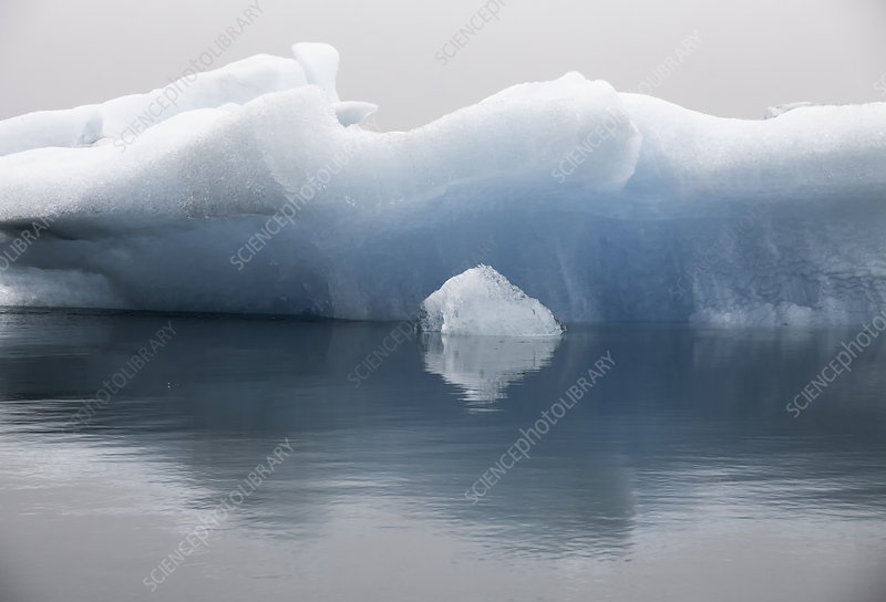 Blue iceberg formation in calm water
