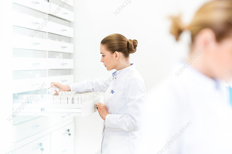 Pharmacist filling prescription