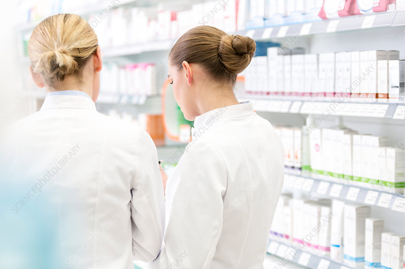 Pharmacists working together in pharmacy