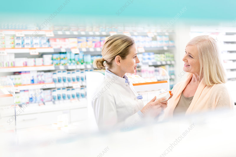 Pharmacist and customer talking