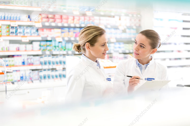 Pharmacists talking in pharmacy