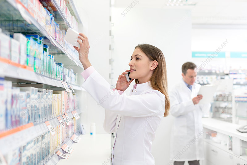 Pharmacist talking on cell phone