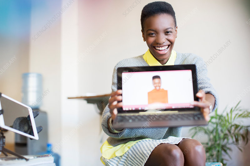 Businesswoman showing photograph of self