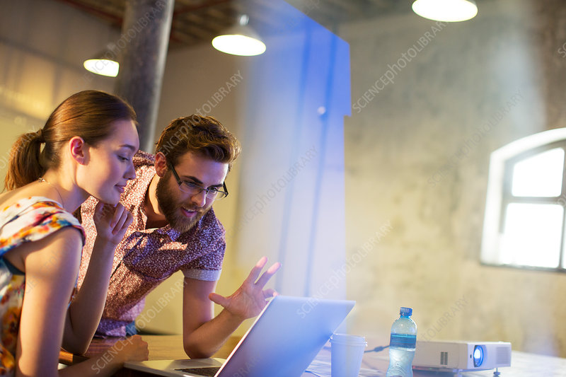 Business people working at laptop