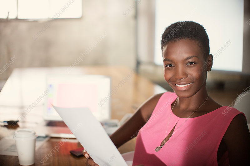 Businesswoman with paperwork in office
