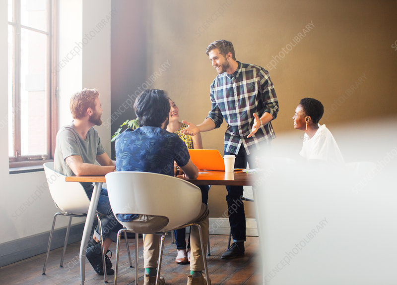Businessman leading meeting at table