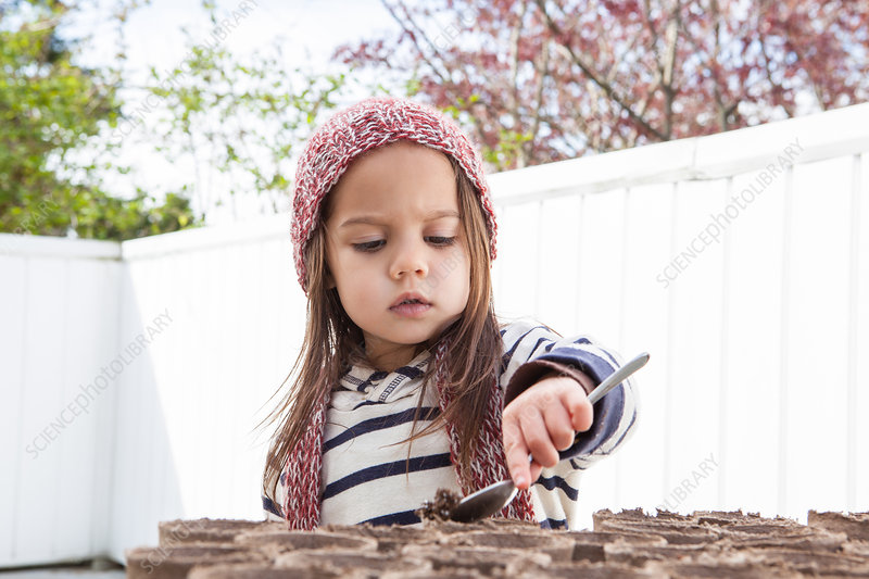 Girl gardening on patio