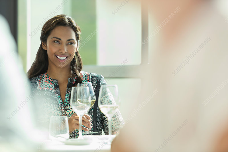 Smiling woman drinking wine