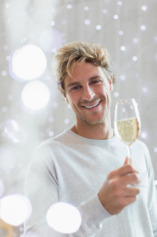 Portrait smiling man drinking white wine