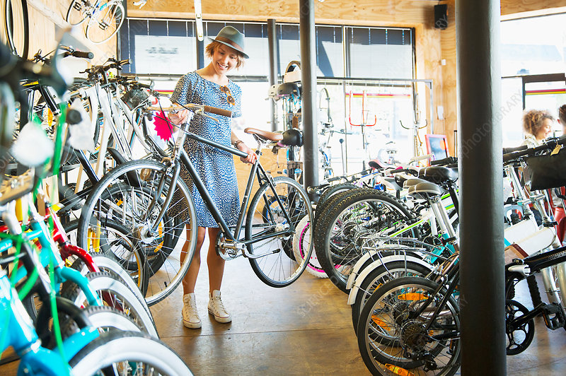 Woman selecting bicycle from rack