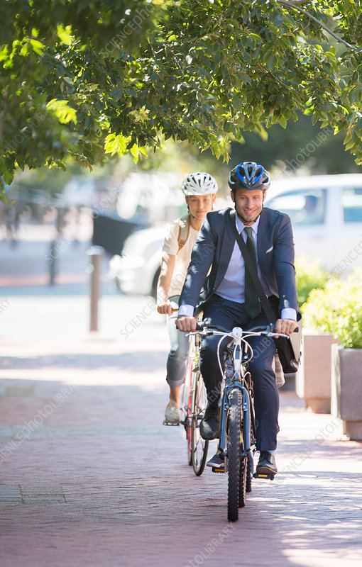 Businessman riding bicycle on path