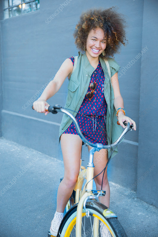 Woman with afro on bicycle
