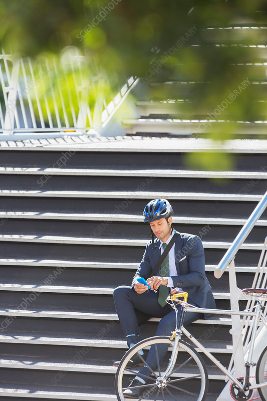 Businessman and bicycle texting