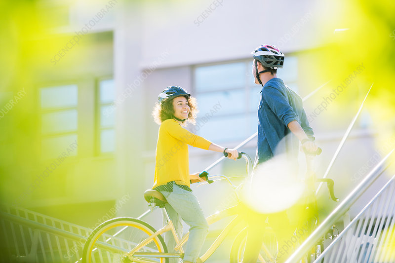Man and womans on bicycles talking
