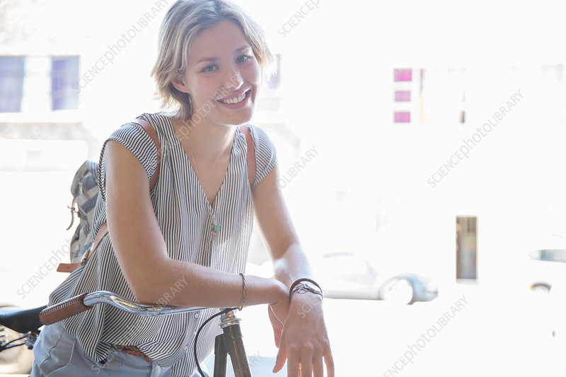 Portrait smiling woman on bicycle