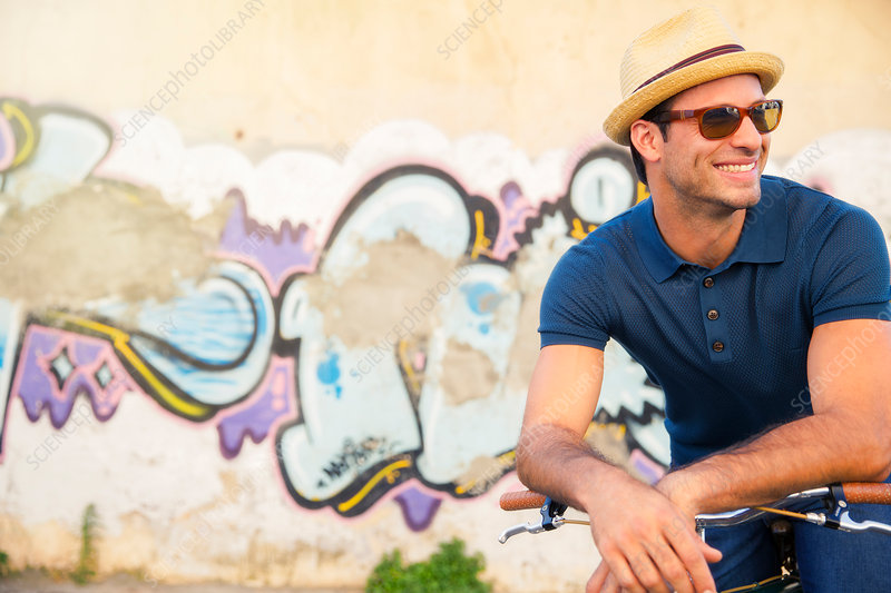 Smiling man in hat and sunglasses