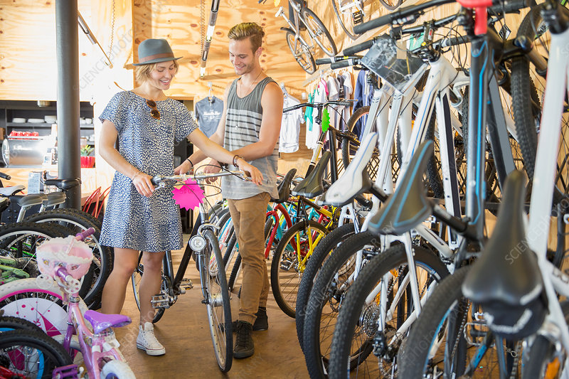 Couple eyeing bicycle in bicycle shop