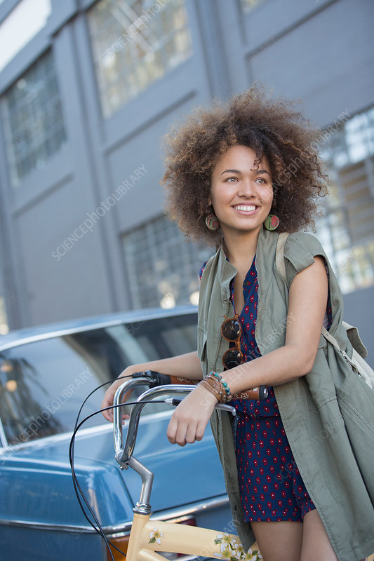 Smiling young woman with afro