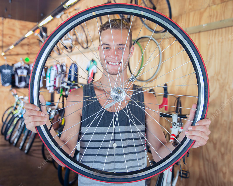 Man holding bicycle wheel