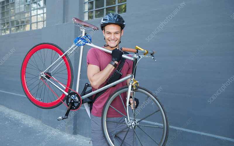 Man carrying bicycle