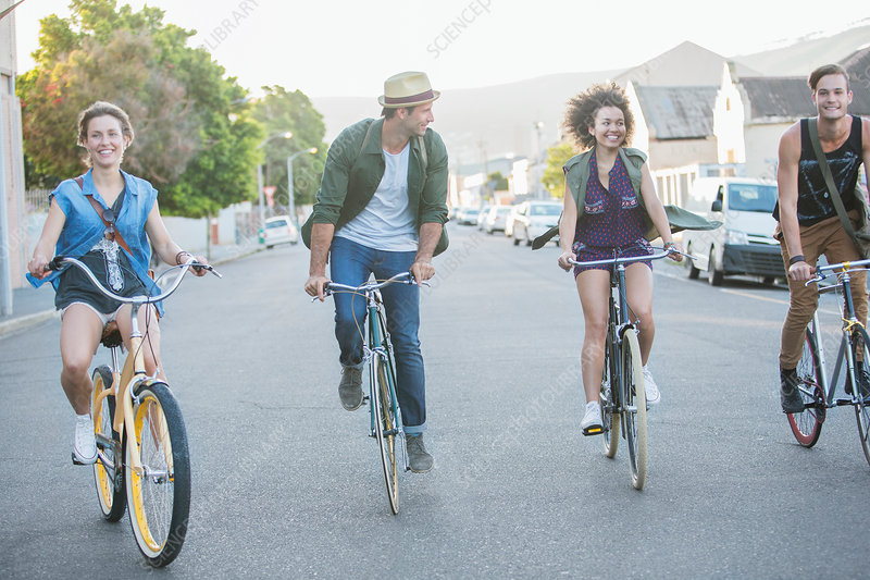 Friends riding bicycles in a row