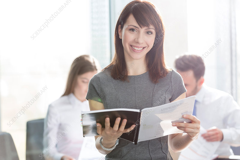 Businesswoman holding report