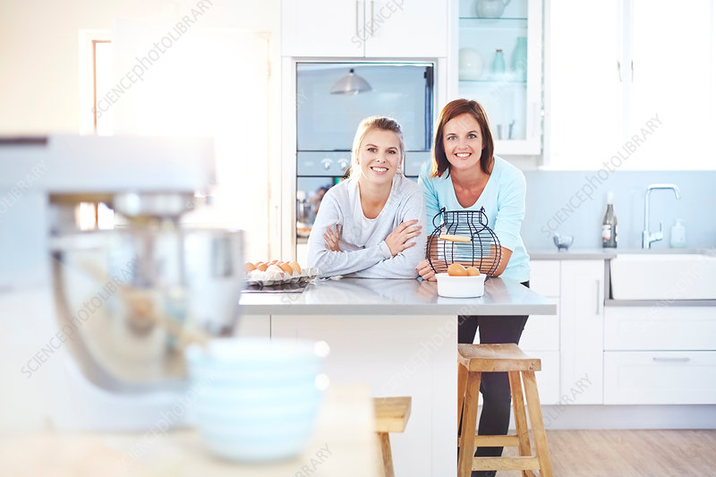 Women leaning on kitchen counter