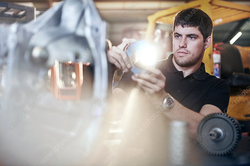 Mechanic examining part