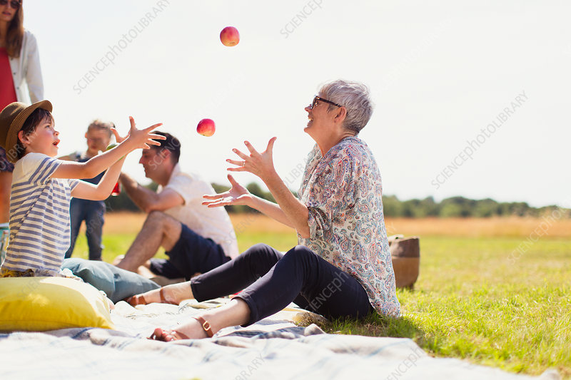 Grandmother and grandson juggling apples