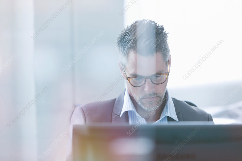 Focused businessman using computer
