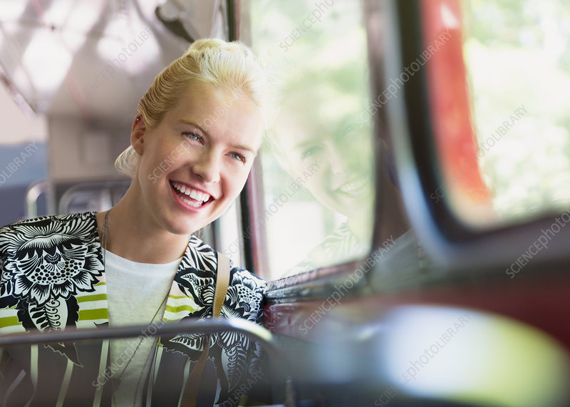 Enthusiastic woman riding bus