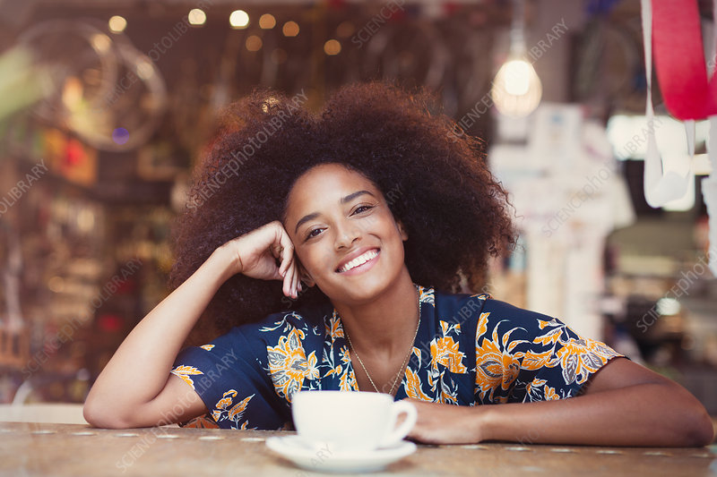 Woman with afro drinking coffee