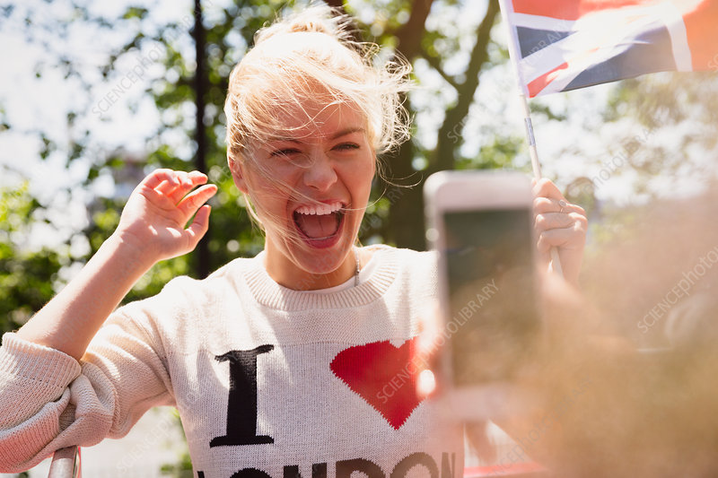 Woman waving British flag