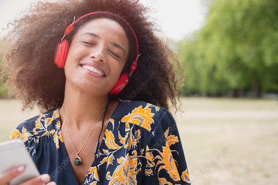 Woman listening to music and mp3 player