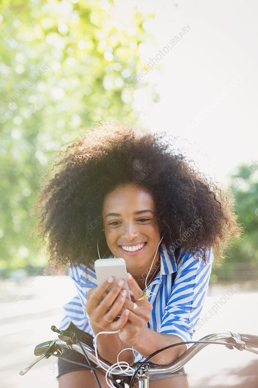 Woman with afro listening to music