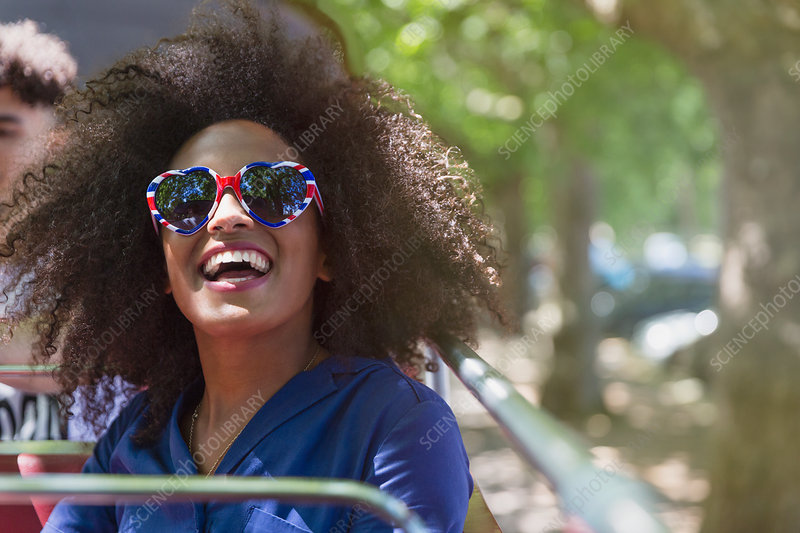 Woman with afro wearing glasses
